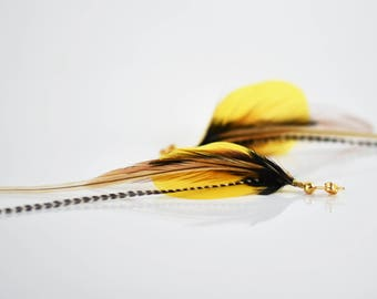 Yellow feather earrings long grizzly feather