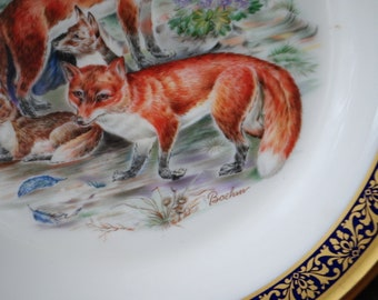 Collectible vintage 70s, porcelain plate with a  Boehm's red foxed print . Made by Lenox.