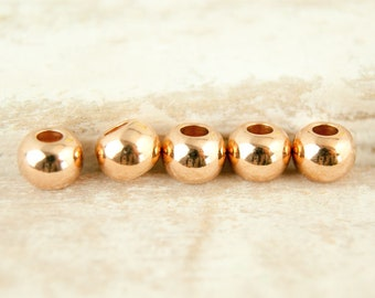 10x beads 6 mm rose gold plated #4818