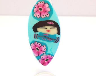 Shuttle kokeshi in polymer clay ring