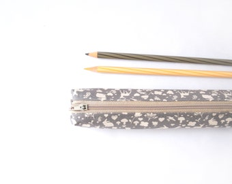 Small pencil case/zipper pouch with tiny rabbits, deer, mushrooms and flowers on dark grey and a light khaki zip