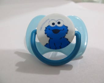 My Baby Alive 2010 Magnetic Pacifier or Reborn Doll Pacifier.  Baby Cookie Monster.  Use drop down menu to see choices.  NO DOLL.  OOAK.