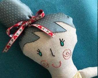 Doll made by hand padded fabric