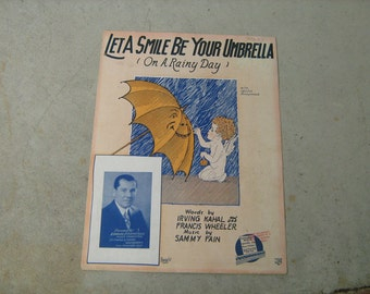 1927  vintage sheet music (  Let a smile be your umbrella  ) on a rainy day