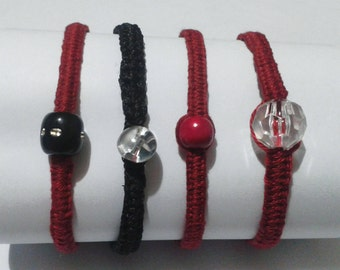 Handmade macrame bracelets with decorative beads in red, transparent white or black