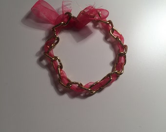 Cute gold coloured metal chain and ribbon bracelet. Pretty wrist chain