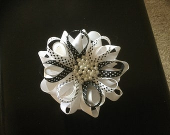 Black and white bow with pearl like beads.