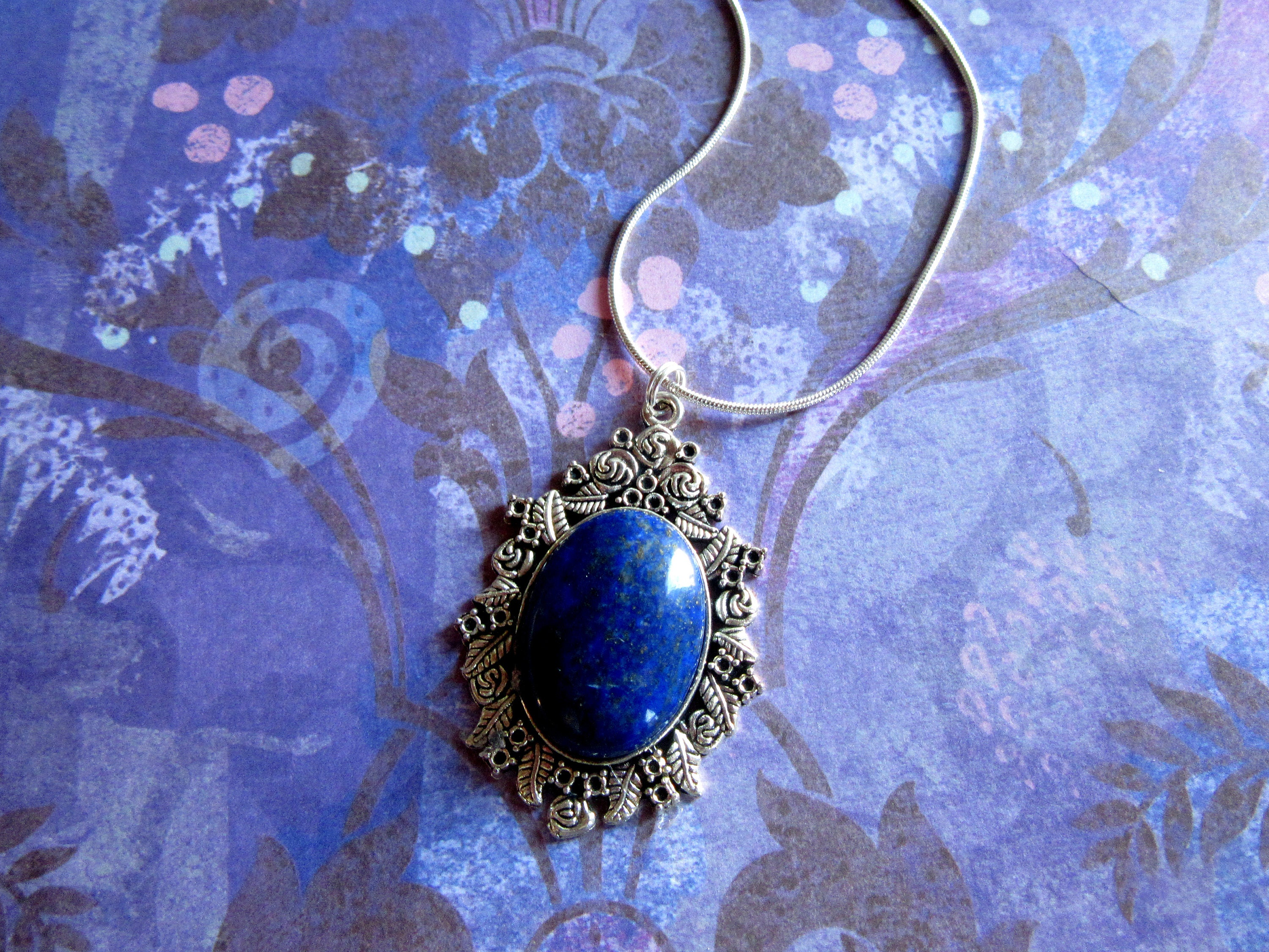 crystal lapis point vaults pendant lazuli