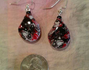 Swirled Earrings in Black, Red, and white, with tiny black glass beads on top. Resin finish