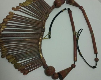 African hand made paddle necklace.