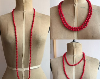 Vintage extra long glass red necklace.