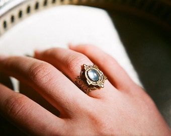 Through the Looking-Glass - Adjustable antiqued brass filigree ring with iridescent blue cabochon