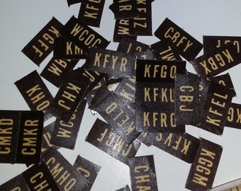 Vintage paper supplies 50 miniature labels brown with yellow radio station call letters ephemera