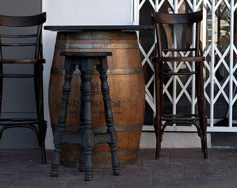 Barrel table at a bar.  Buy and frame pictures online. Your own photo canvas easily. Use professional photos to decoration.