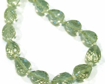 Prasiolite/green amethyst micro-faceted teardrops, length-drilled.  Approx. 6x8.25mm.  Select a quantity.