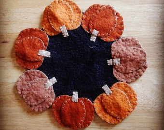 Small pumpkin penny rug fall candle mat