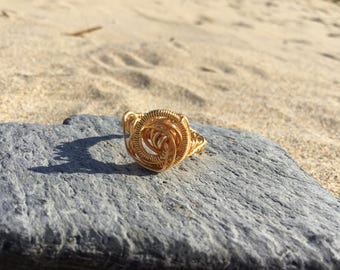 Size N wire wrapped flower ring. Can be made to order
