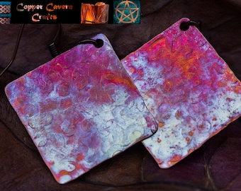 Fire patina textured copper square earrings in pinks and purples