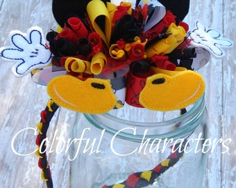 Over the top Mickey Parts woven head band, funky loopy bow, red yellow and black