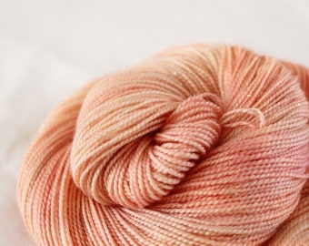 Peach Fizz - Magpie -  75/20/5 superwash merino/ nylon/ gold stellina sock yarn