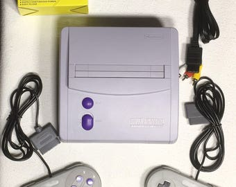 Super Nintendo Console SNES JR with 2 brand new controllers and Power and AV Cables. (Non discolored)