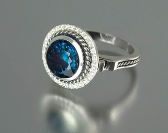 TATIANA statement silver halo ring with London Blue Topaz