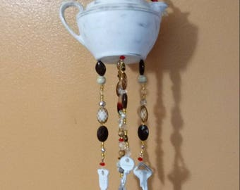 Distressed white silverplate creamer and key windchime, silverware wind chime, browns and reds, key windchime