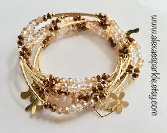 Metallic gold transcendent beaded bracelets with gold plated charms - Semanario oro metalico transendente con dijes de chapa de oro