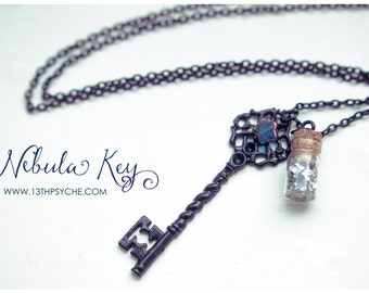 Black key and glitter bottle necklace. Black key pendant, skeleton key pendant, glass bottle necklace with glitter,antique key necklace