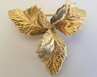 Burning Bush brooch, gold leaf, three leaves covered in gold