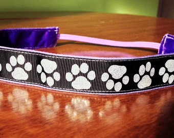 NOODLE HUGGER Non slip ribbon headband - white paws on black - 7/8 inch (running, working out, everyday: women and girls)