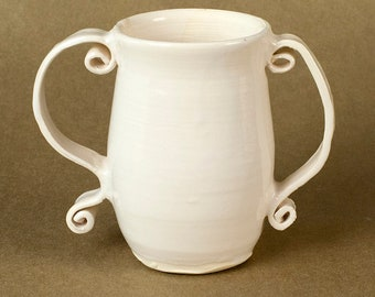 Vase with curved handles
