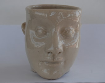 head sculpture mug