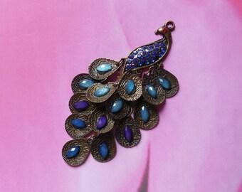 1 pendant of peacock blue bronze