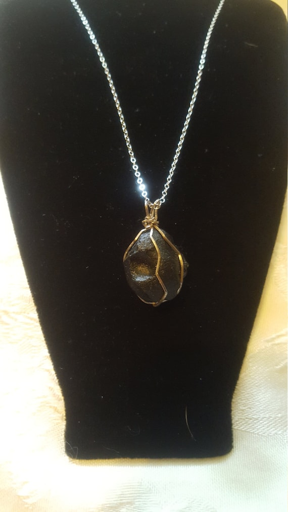Tektite and sterling silver pendant