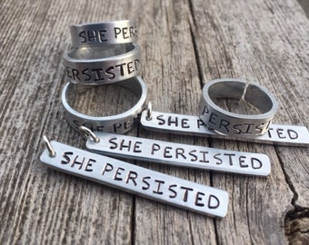She Persisted Hand-Stamped Rings & Pendants