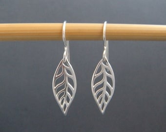 modern sterling silver leaf earrings. small simple dangles leverback lever back hook flat leaves botanical nature drop delicate jewelry gift