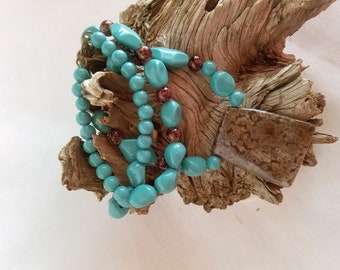 Turquoise and brown rock pendant necklace