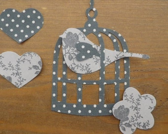Applique Bird and Bird Cage in dotty/floral iron on fabric.