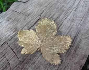 Gold tone autumn leaf