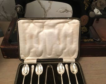Set of six Solid Silver tea Spoons and sugar tongs in original box,