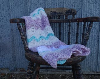 crochet baby blanket in pastel colours