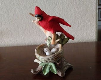 Cardinal with nest and eggs figurine
