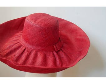 Great Sun Hat has wide brim finely handwoven raffia with a bow on the side, Red