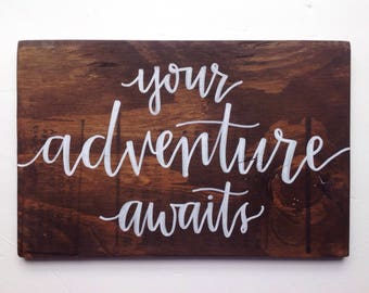 "Dark Stain Wood Sign ""Your Adventure Awaits""  With White Hand Lettering"