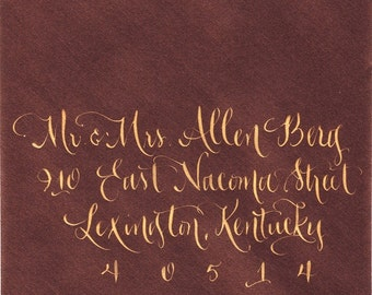 Envelope addressing calligraphy for wedding in gold ink - hand lettering