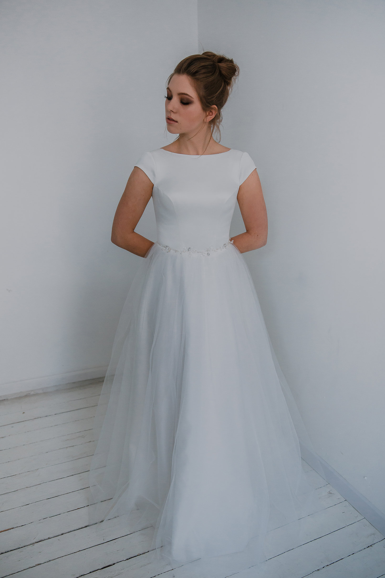 Ivory wedding dress with tulle skirt and silky top. Open back