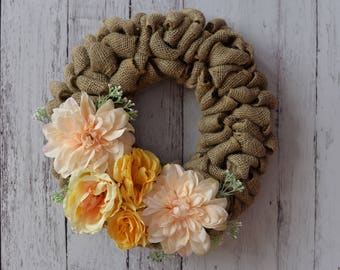 Burlap Wreath with yellow and rose coloured flowers