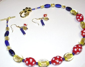 Red and white polka dots, bright yellow and cobalt blue necklace and earrings