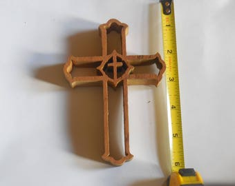 small wooden cross great for a small office space